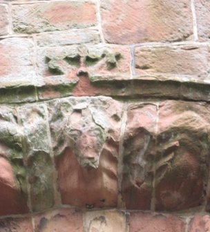 face at St Bees priory Cumbria