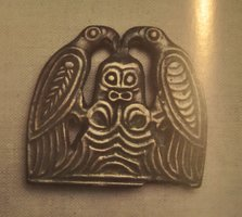 Finno-Ugrian amulet man with two birds